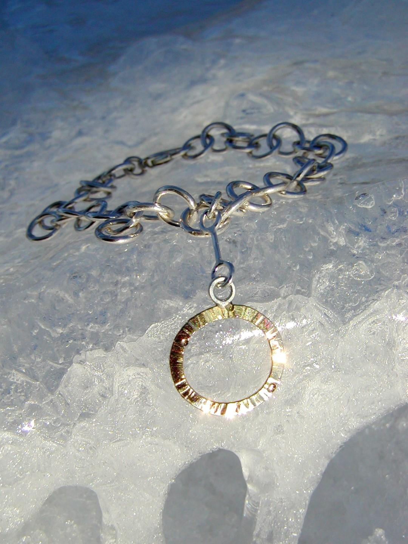 Armband i sterlingsilver med hänge i 18k guld
